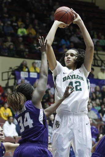 Baylor center Brittney Griner (42) shoots over Kansas State forward Branshea Brown (34) in the first half of the third round of an NCAA college women's Big 12 conference basketball tournament, Friday, March 9, 2012 in Kansas City, Mo. (AP Photo/Jeff Tuttle)