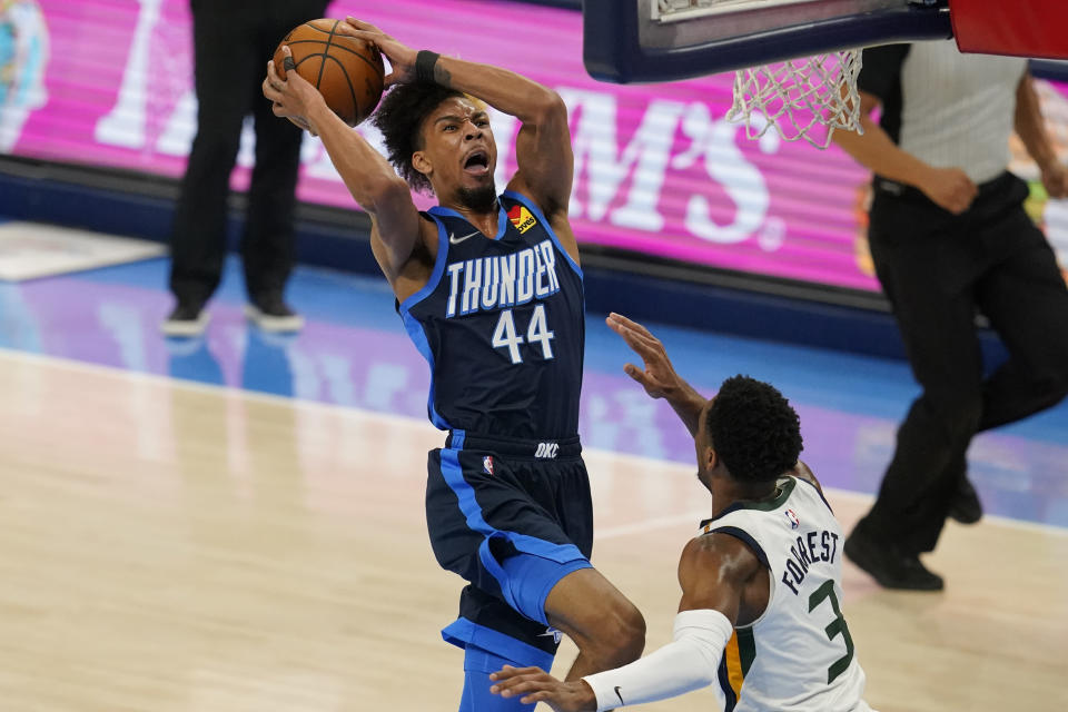 Oklahoma City Thunder forward Charlie Brown Jr. (44) shoots over Utah Jazz guard Trent Forrest (3) in the second half of an NBA basketball game Friday, May 14, 2021, in Oklahoma City. (AP Photo/Sue Ogrocki)