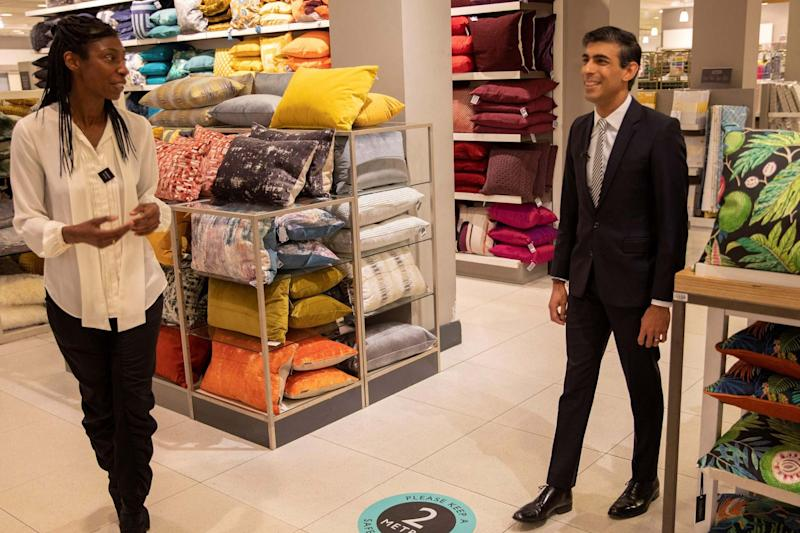 Chancellor Rishi Sunak with John Lewis chairman Sharon White during a visit to a store in London last month (HM TREASURY/AFP via Getty Images)