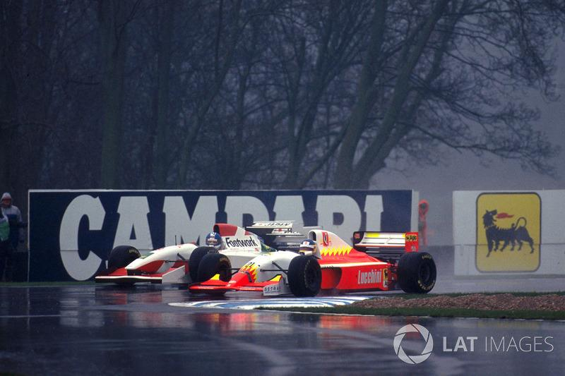 "Poignant moment at Donington in 1993, as Alboreto in the hopeless Lola-Ferrari duels with his replacement at Arrows, Derek Warwick. <span class=""copyright"">Sutton Images</span>"