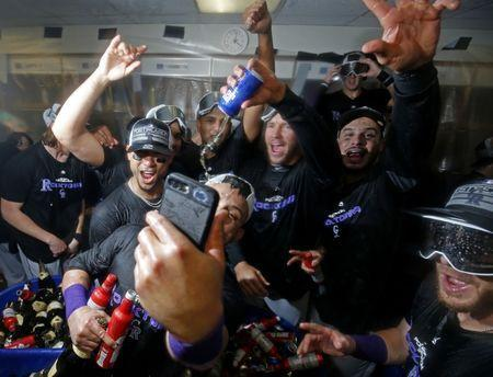 Oct 2, 2018; Chicago, IL, USA; Colorado Rockies players celebrate in the clubhouse after defeating the Chicago Cubs in the 2018 National League wild card playoff baseball game at Wrigley Field. Mandatory Credit: Jim Young-USA TODAY Sports