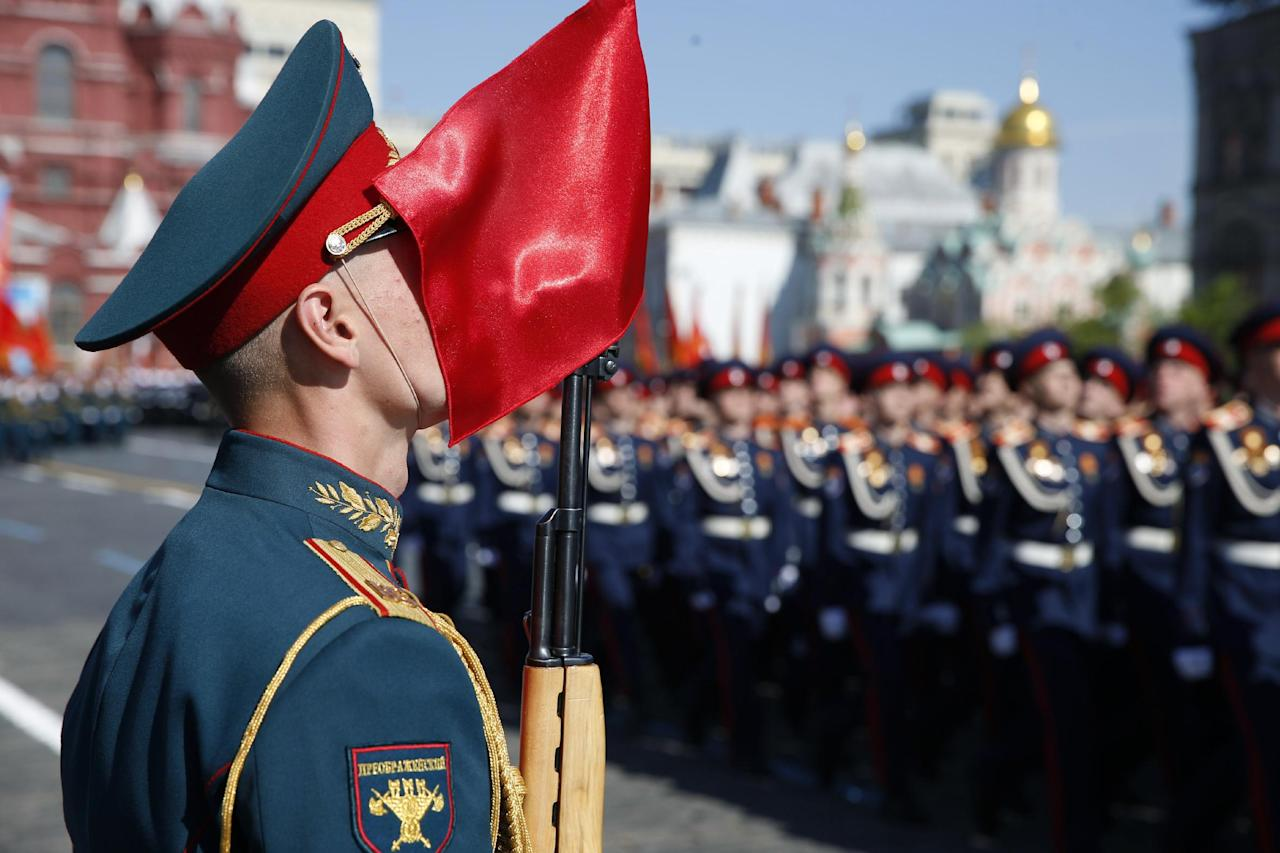 Russian troops march during a Victory Day parade, which commemorates the 1945 defeat of Nazi Germany, at Red Square in Moscow, Russia, Friday, May 9, 2014. Russia marked the Victory Day on May 9 holding a military parade at Red Square. (AP Photo/Pavel Golovkin)