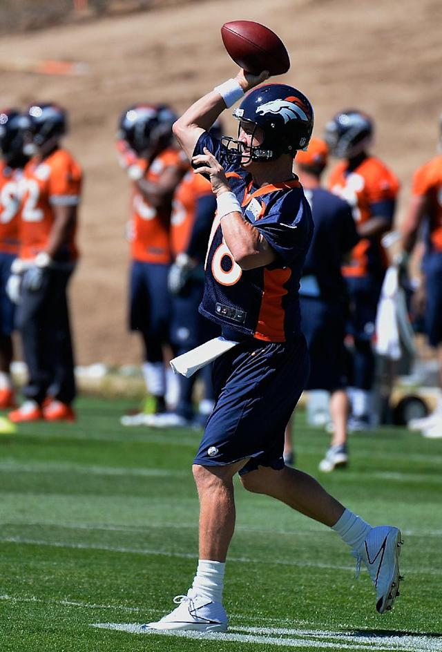 Denver Broncos quarterback Peyton manning throws during an NFL football organized team activity, Wednesday, May 28, 2014, in Englewood, Colo., (AP Photo/Jack Dempsey)