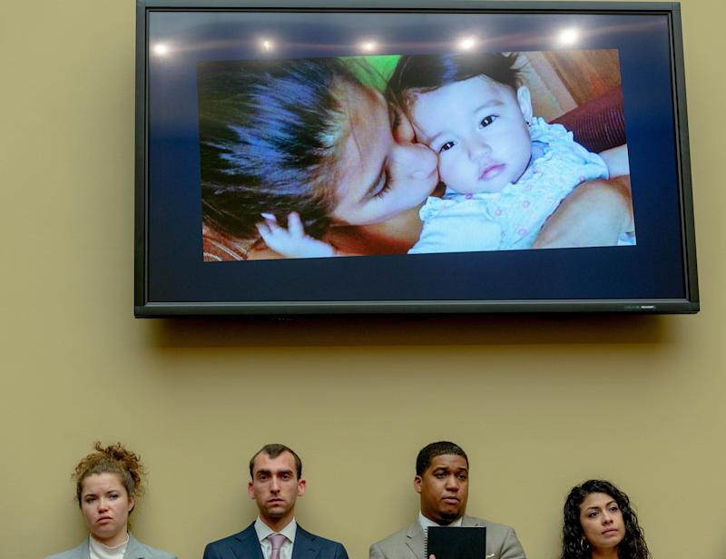 People listen to the story of Yazmin Juárez with Juárez and her daughter Mariee's photo on the screen on July 10, 2019 in Washington.
