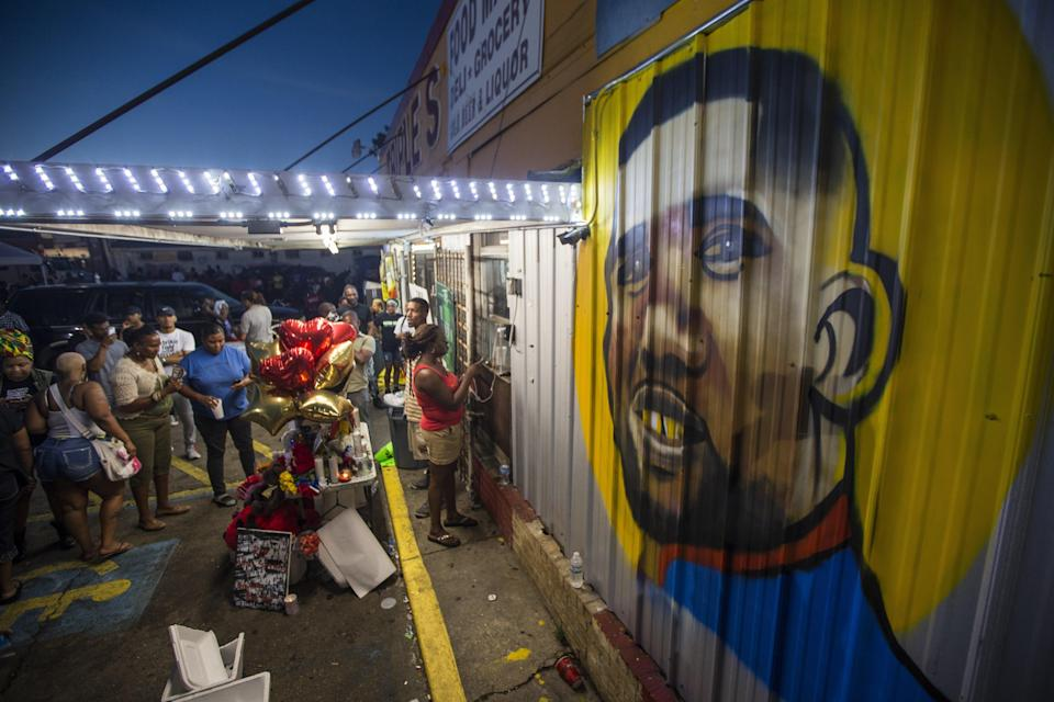 Protesters gather outside a mural of Alton Sterling in July 2016 (Getty Images)