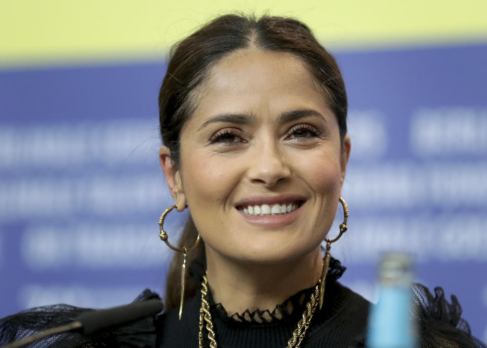 Actress Salma Hayek attends a press conference for the film 'The Roads Not Taken' at the 70th International Film Festival, Berlinale, in Berlin, Germany, Wednesday, Feb. 26, 2020. (AP Photo/Michael Sohn)