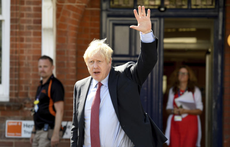 Britain's Prime Minister Boris Johnson leaves after a visit to Torbay Hospital, south England Friday Aug. 23, 2019, after he welcomed a review into hospital food. (Finnbarr Webster/Pool via AP)