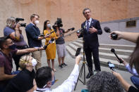 """California Gov. Gavin Newson responds to a question while meeting with reporters after casting his recall ballot at a voting center in Sacramento, Calif., Friday, Sept. 10, 2021. The last day to vote in the recall election is Tuesday Sept. 14. A majority of voters must mark """"no"""" on the recall to keep Newsom in office. (AP Photo/Rich Pedroncelli)"""