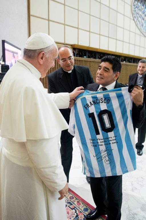 Pope Francis accepts a presents of Diego Maradona's famous Number 10 Argentina jersey with the pontiff's name on the back in 2014