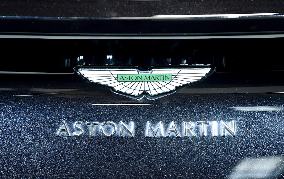 The logo of Aston Martin is seen on a car displayed at the Aston Martin stand during the press days of the Paris Motor Show on October 3, 2018. - Aston Martin on October 3, 2018 launched on the London stock market, valuing the British luxury sports car brand at £4.3 billion ($5.6 billion, 4.9 billion euros). (Photo by ERIC PIERMONT / AFP) (Photo by ERIC PIERMONT/AFP via Getty Images)