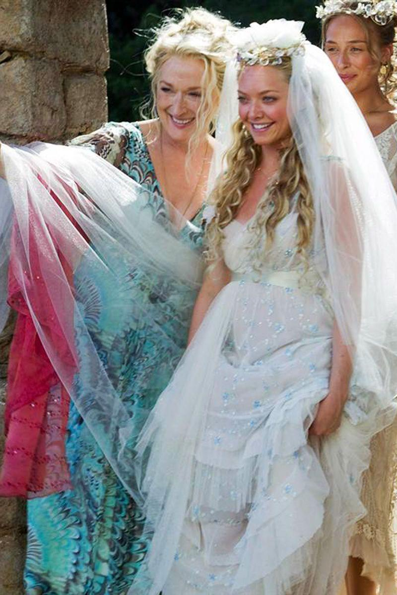 <p>What dress is fit for a Grecian island wedding? Naturally, that would be the empire-waist, tulle, and blue-beaded bohemian wedding gown Amanda Seyfried wore as Sophie.<br></p>