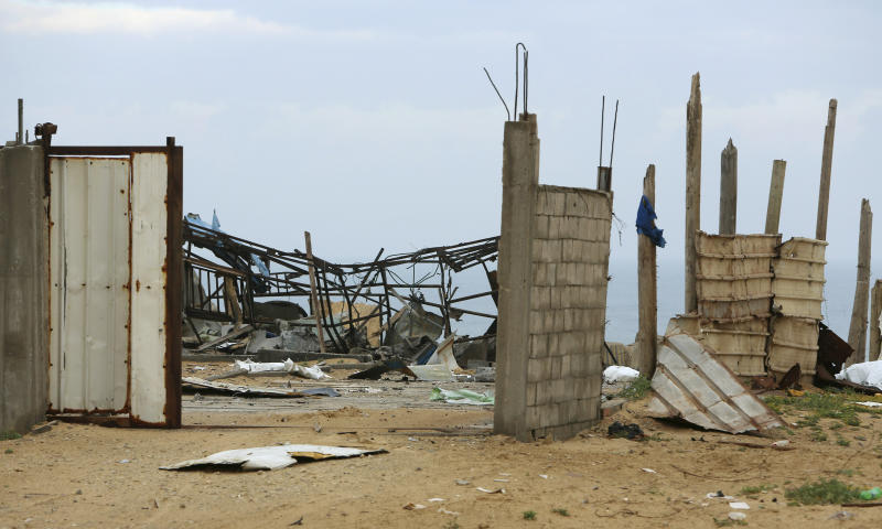 A wreckage of Hamas military site is seen empty after it hit by Israeli airstrikes in Gaza City, early Friday, Friday, March 15, 2019. Israeli warplanes attacked militant targets in the southern Gaza Strip early Friday in response to a rare rocket attack on the Israeli city of Tel Aviv, as the sides appeared to be hurtling toward a new round of violence. (AP Photo/Adel Hana)