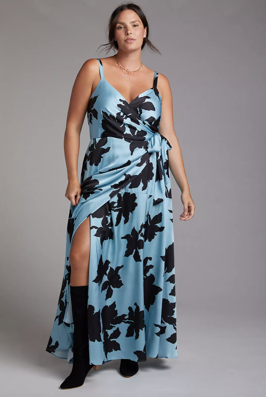 plus size model with brown hair wearing blue floral print silk maxi dress