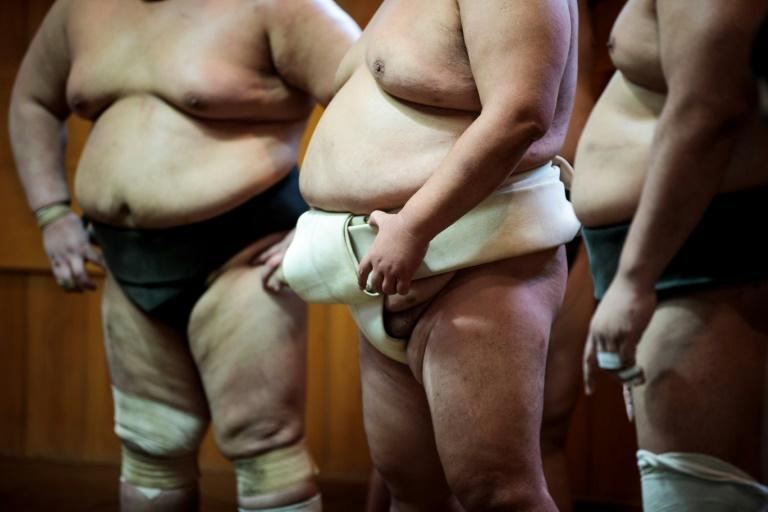 Sumo wrestlers attend a training session at a stable in Tokyo last year. A handful of lower-ranking sumo wrestlers, trainees and a stable master have contracted coronavirus in Japan