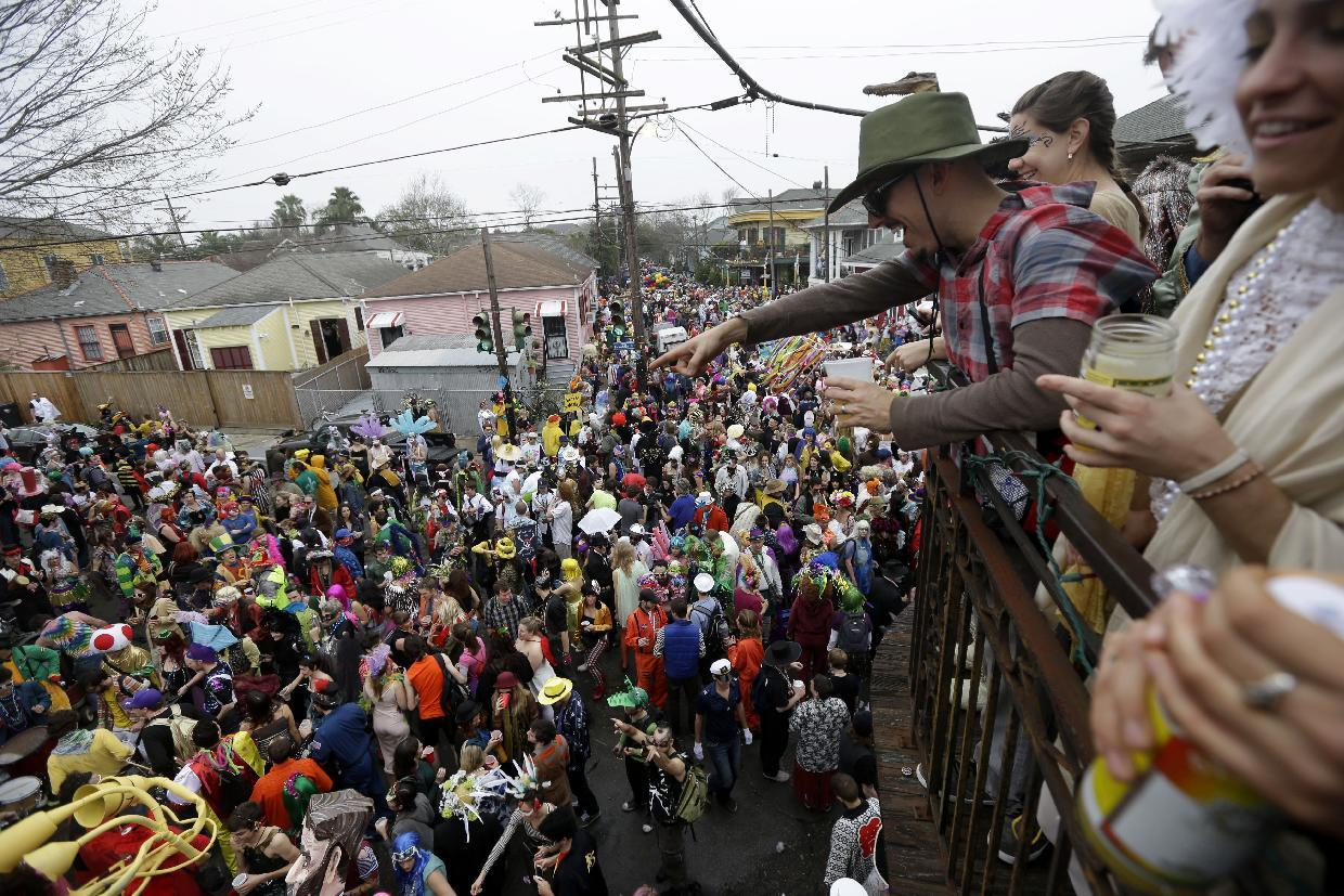 Revelers gather for the start of the Society of Saint Anne walking parade in the Bywater section of New Orleans during Mardi Gras day, Tuesday, Feb. 12, 2013. Overcast skies and the threat of rain couldn't dampen the revelry of Mardi Gras as parades took to the streets, showering costumed merrymakers with trinkets of all kinds. (AP Photo/Gerald Herbert)