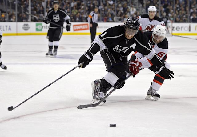 Los Angeles Kings center Anze Kopitar, left, of Slovena, and New Jersey Devils defenseman Andy Greene battle for the puck during the second period of an NHL hockey game, Thursday, Nov. 21, 2013, in Los Angeles. (AP Photo/Mark J. Terrill)