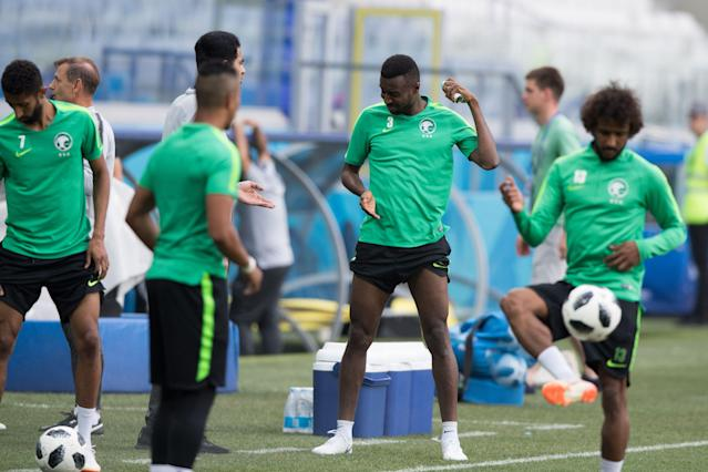 <p>Saudi Arabia's defender Osama Hawsawi sprays an insect repellent during a training session at the Volgograd Arena in Volgograd on June 24, 2018, on the eve of the Russia 2018 World Cup Group A football match between Saudi Arabia and Egypt. (Photo by NICOLAS ASFOURI / AFP) </p>