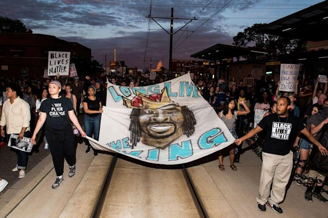 Protesters carry a banner depicting Philando Castile on June 16 in St Paul, Minn. (Photo: Stephen Maturen/Getty Images)