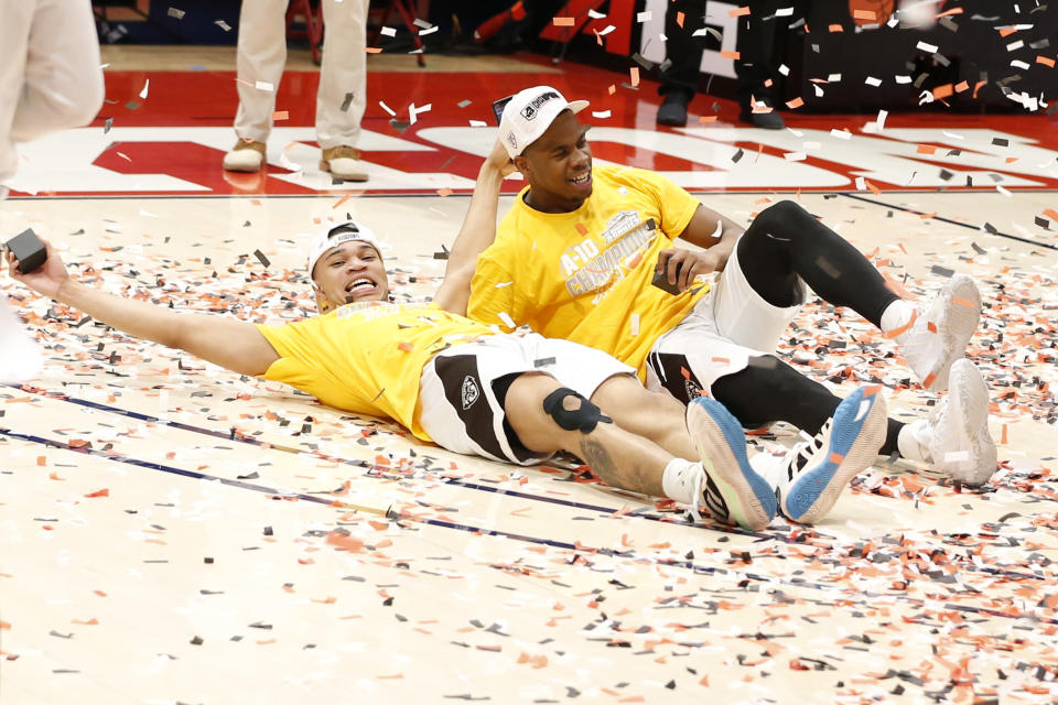 St. Bonaventure's Jaren Holmes, left, and Alpha Okoli celebrate after beating VCU in an NCAA college basketball championship game for the Atlantic Ten Conference tournament Sunday, March 14, 2021, in Dayton, Ohio. St. (AP Photo/Jay LaPrete)