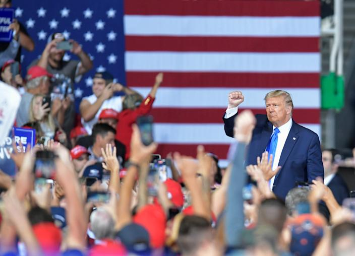 President Donald Trump waves to the crowd as he leaves Thursday, September 24, 2020 at the Great American Comeback Event at the Cecil Commerce Center in Jacksonville, Florida. (Will Dickey/Florida Times-Union)