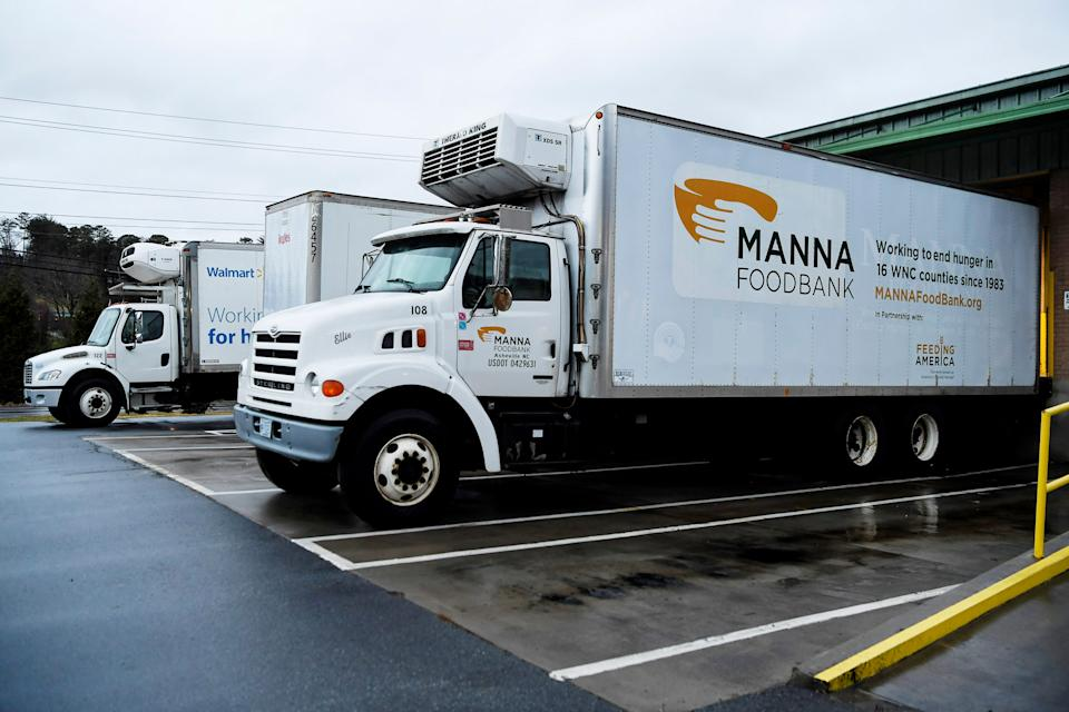 A fleet of MANNA FoodBank's delivery trucks at their distribution center December 17, 2019.