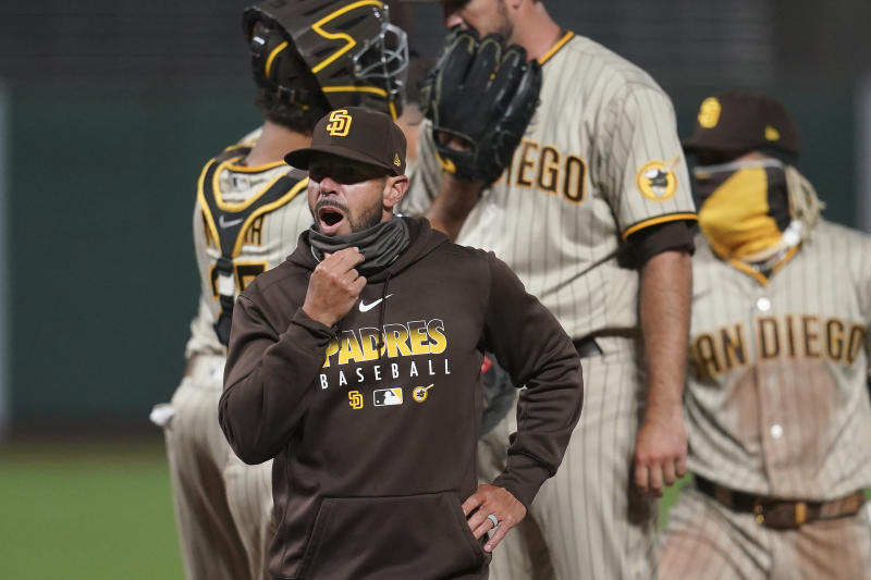 San Diego Padres manager Jayce Tingler walks off the mound after making a pitching change during the seventh inning of a baseball game against the San Francisco Giants in San Francisco, Thursday, July 30, 2020. (AP Photo/Jeff Chiu)