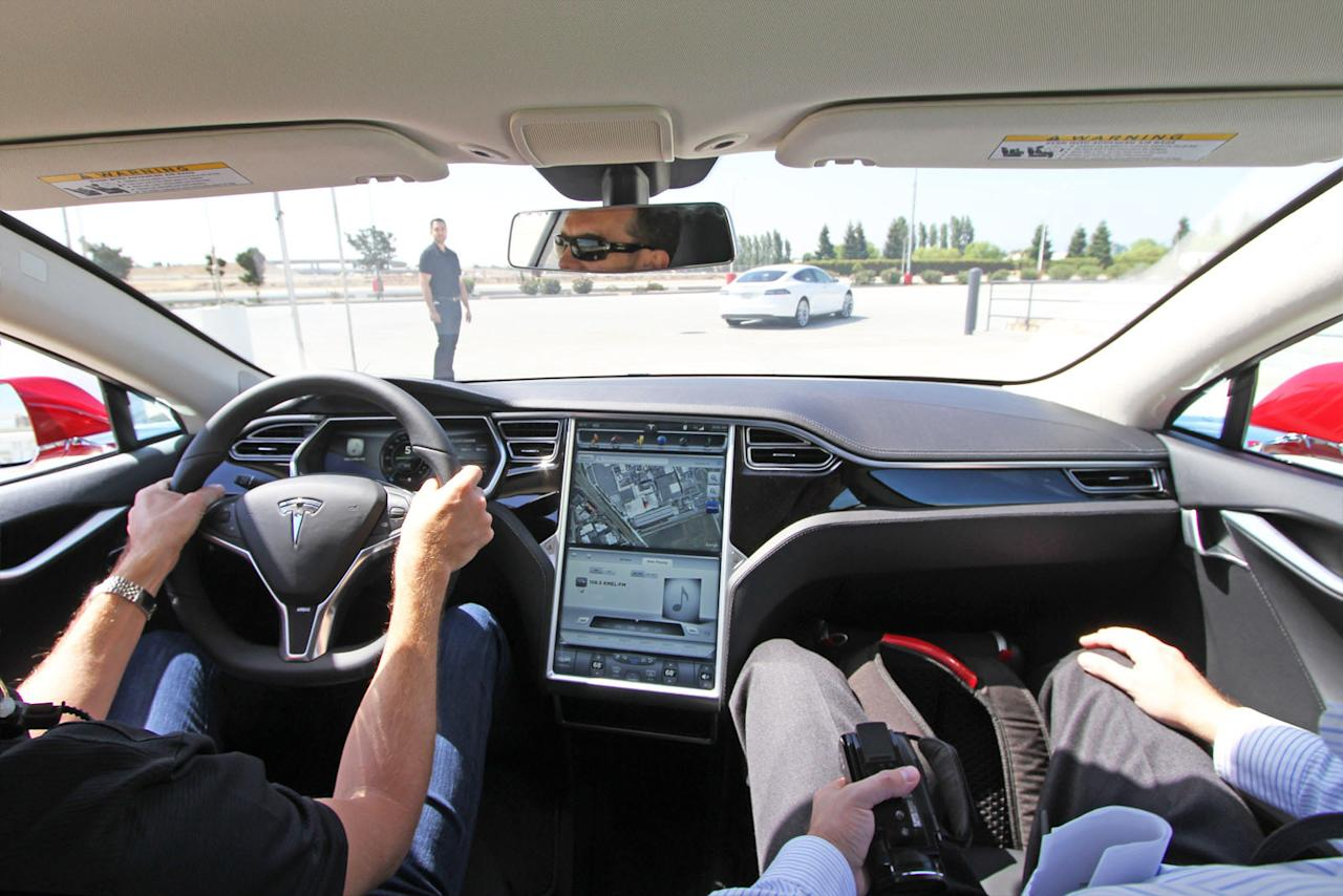 A 17-inch touchscreen fills the dash of the Tesla Model S.