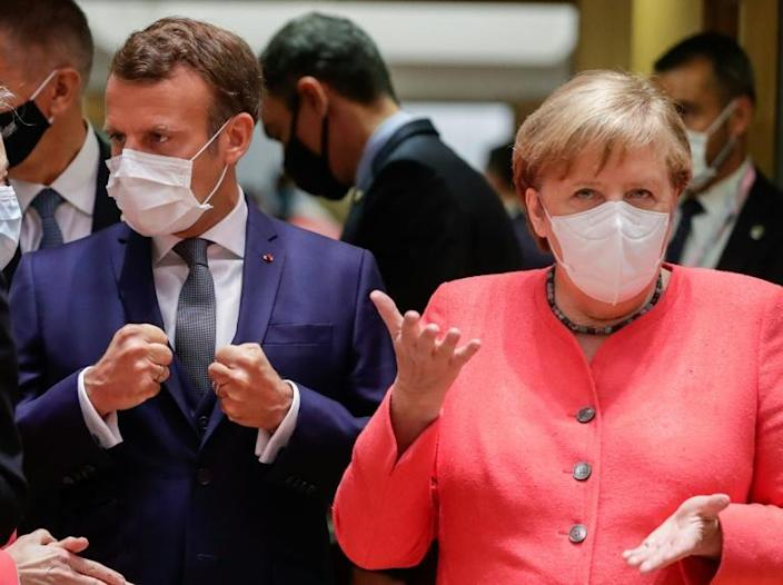 German Chancellor Angela Merkel and French President Emmanuel Macron are in Brussels to try and thrash out an EU coronavirus rescue package (AFP Photo/STEPHANIE LECOCQ)