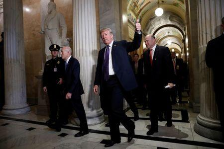 """U.S. President Donald Trump arrives with Director of the National Economic Council Gary Cohn at the U.S. Capitol to meet with House Republicans ahead of their vote on the """"Tax Cuts and Jobs Act"""" in Washington, U.S., November 16, 2017. REUTERS/Aaron P. Bernstein"""