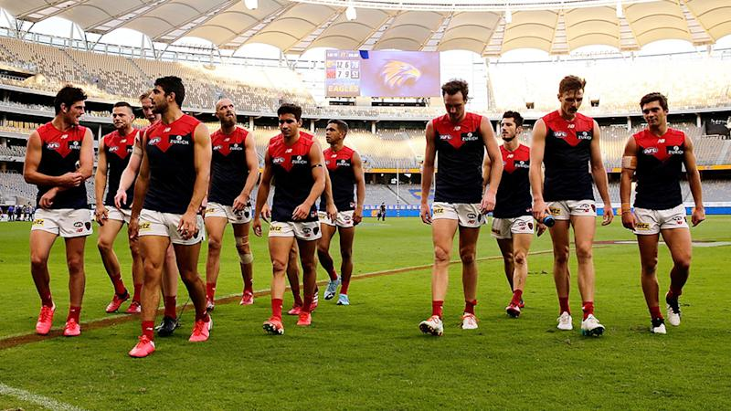 Pictured here, the Melbourne Demons walk off after their round one loss to West Coast.