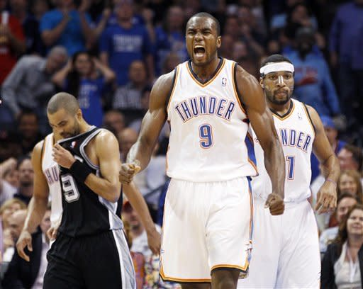 Oklahoma City Thunder forward Serge Ibaka (9), of Republic of Congo, reacts after being fouled in front of San Antonio Spurs guard Tony Parker (9) and Thunder forward Lazar Hayward, right, during the second quarter of an NBA basketball game in Oklahoma City, Friday, March 16, 2012. (AP Photo/Sue Ogrocki)