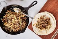 """Sauté hot Italian sausage meat with ginger and garlic, mix with veg, and dinner's a wrap! <a href=""""https://www.epicurious.com/recipes/food/views/one-skillet-hot-sausage-and-cabbage-stir-fry-with-chives?mbid=synd_yahoo_rss"""" rel=""""nofollow noopener"""" target=""""_blank"""" data-ylk=""""slk:See recipe."""" class=""""link rapid-noclick-resp"""">See recipe.</a>"""