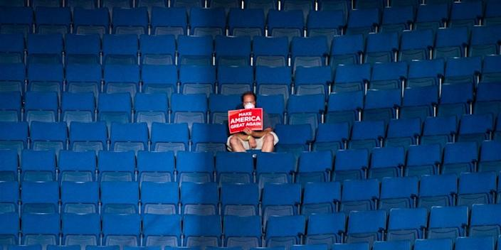 A supporter alone in the top sections of seating before President Donald Trump arrived for his rally in Tulsa, Oklahoma, on Saturday.