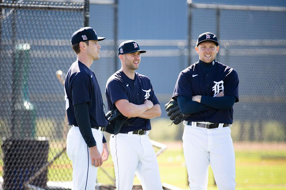 (From left) Tigers pitchers Joey Wentz, Alex Lange and Zack Hess talk during their workout at Joker Marchant Stadium in Lakeland, Florida, on Saturday, Feb. 20, 2021.