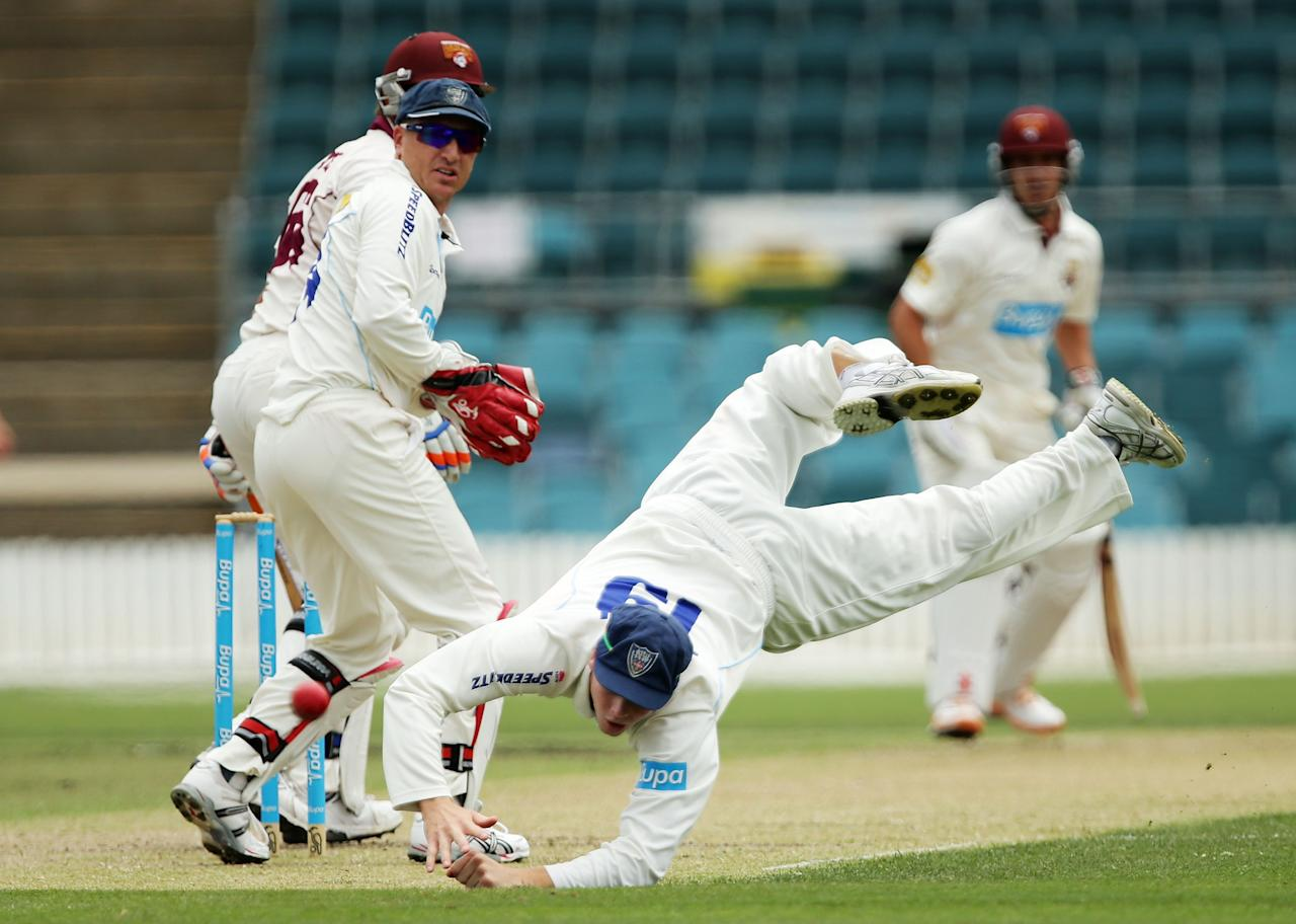CANBERRA, AUSTRALIA - NOVEMBER 27:  Steve Smith of the Blues misses a chance to catch Peter Forrest of the Bulls off the bowling of Steve O'Keefe during day one of the Sheffield Shield match between the New South Wales Blues and the Queensland Bulls at Manuka Oval on November 27, 2012 in Canberra, Australia.  (Photo by Matt King/Getty Images)