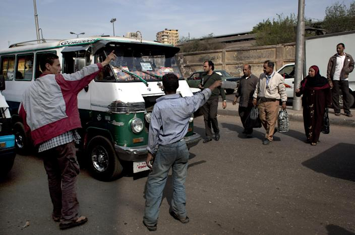 Egyptian drivers close the road and prevent public transportation vehicles from reaching the main bus station, during a protest on the outskirts of Cairo, Egypt, Monday, March 11, 2013. On Sunday, drivers of Cairo's popular communal taxis staged a strike to protest fuel shortages, creating a traffic nightmare on the already congested streets of the city. Some of the drivers, armed with knives and firearms, attacked others who did not observe the strike or got into fights with motorists angered by their action. (AP Photo/Nasser Nasser)
