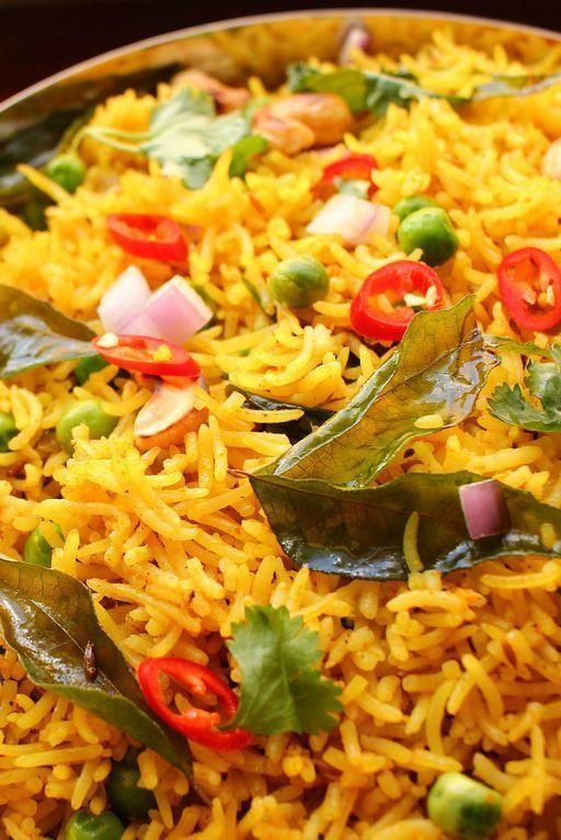 """<p>This version of curry rice is a sort of pilaf: rice is toasted in aromatic butter before being steamed to perfection. Perfectly spiced, it makes for a solid side dish, or a filling main.</p><p>Get the <a href=""""https://www.delish.com/uk/cooking/recipes/a33796271/curry-rice-recipe/"""" rel=""""nofollow noopener"""" target=""""_blank"""" data-ylk=""""slk:Curried Rice"""" class=""""link rapid-noclick-resp"""">Curried Rice</a> recipe. </p>"""