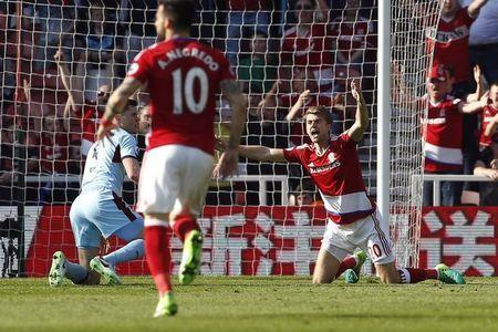 Britain Football Soccer - Middlesbrough v Burnley - Premier League - The Riverside Stadium - 8/4/17 Middlesbrough's Patrick Bamford appeals to the referee after being fouled by Burnley's Michael Keane Action Images via Reuters / Craig Brough Livepic