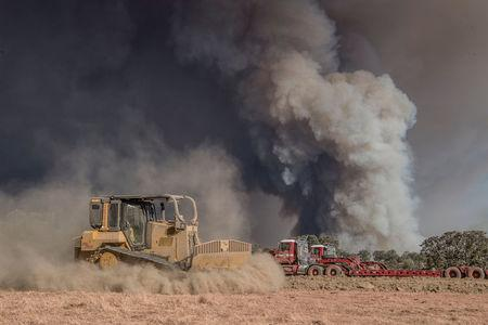 A Cal Fire bulldozer makes a safety zone on Shilling Ranch after authorities ordered evacuations due to the Detwiler fire in Mariposa, California, U.S. July 18, 2017. REUTERS/Al Golub