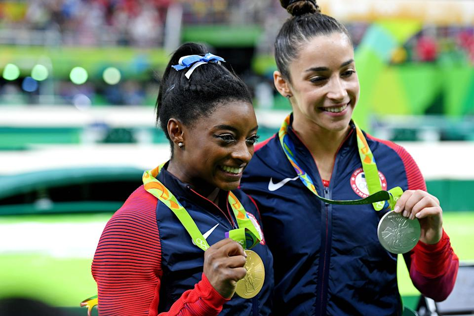 Biles with Aly Raisman after winning gold and silver in the women's individual all-around at the 2016 Olympics in Rio.