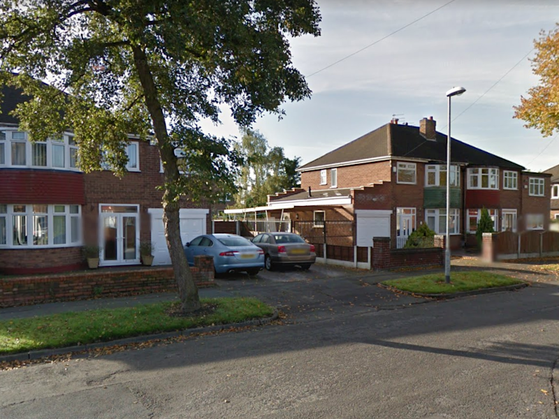 Robbers held a 14-year-old girl at gunpoint during a raid at a family home in Wythenshawe, south Manchester: Google Street View