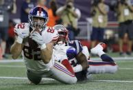 New York Giants tight end Scott Simonson (82) catches a touchdown pass as New England Patriots safety Malik Gant makes the tackle in the end zone in the second half of an NFL preseason football game, Thursday, Aug. 29, 2019, in Foxborough, Mass. Simonson was injured on the play. (AP Photo/Steven Senne)
