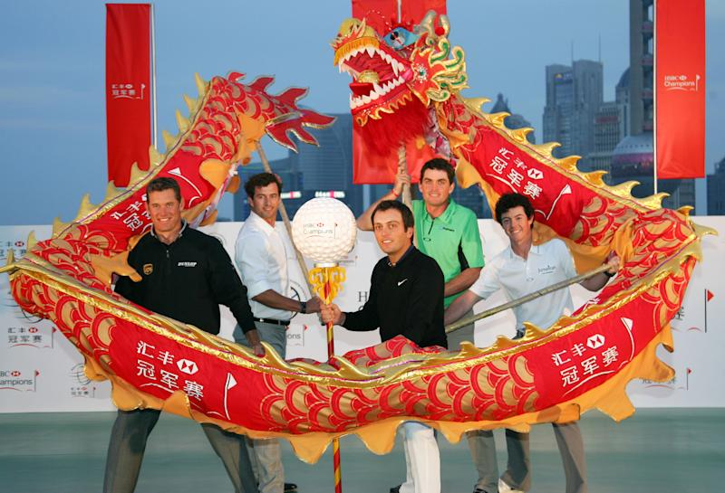 From left to right, Lee Westwood of Britain, Adam Scott of Australia, Francesco Molinari of Italy, Keegan Bradley of the U.S. , Rory Mcllroy of Northern Ireland, pose with a performance dragon during a photo call in Shanghai, China Tuesday, Nov. 1, 2011.  The golfers are in Shanghai for the HSBC Champions golf tournament to be held at Shanghai's Sheshan International Golf Club, which kicks off on Thursday Nov. 3. (AP Photo)