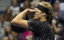 Alexander Zverev, of Germany, reacts after losing a point to Novak Djokovic, of Serbia, during the semifinals of the US Open tennis championships, Friday, Sept. 10, 2021, in New York. (AP Photo/Elise Amendola)