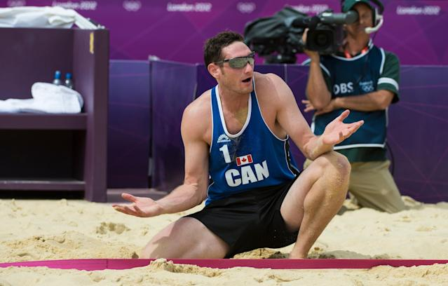 Canada's Joshua Binstock argues an out-of-bounds call during preliminary beach volleyball action against Tarjei Viken Skarlund and Martin Spinnangr at the 2012 London Olympics, on July 30, 2012. Binstock and his partner Martin Reader lost two sets to none.