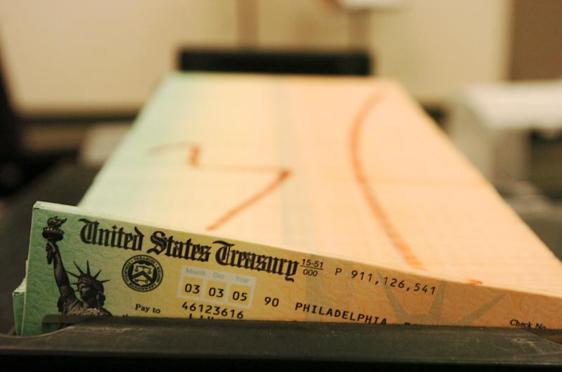 FILE - This February 2005 file photo shows trays of printed social security checks, in Philadelphia, waiting to be mailed from the U.S. Treasury. People retiring today are part of the first generation of workers who have paid more in Social Security taxes during their careers than they will receive in benefits after they retire. It's a historic shift that will only get worse for future retirees, according to an analysis by The Associated Press. Previous generations got a much better bargain, mainly because payroll taxes were very low when Social Security was enacted in the 1930s and remained so for decades. (AP Photo/Bradley C. Bower, File)