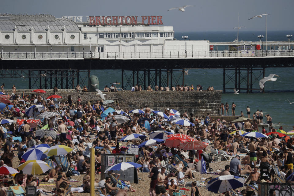 FILE - In this file photo dated Wednesday, June 24, 2020, large numbers of people relax on the beach in Brighton, England. The British government insists that science is guiding its decisions as the country navigates its way through the coronavirus pandemic. But a self-appointed group of independent experts led by a former government chief adviser says it sees little evidence-based about Britain's response. Unlike other countries, the scientific opposition to Britain's approach is remarkably organized. The independent group sits almost in parallel to the government's own scientists, assesses the same outbreak indicators and has put out detailed reports on issues such contact tracing, reopening schools and pubs, and relaxing social distancing. (AP Photo/Matt Dunham, File)