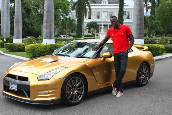 Usain Bolt takes delivery of his gold GT-R