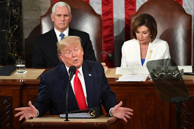 Trump delivers the State of the Union address, flanked by Vice President Mike Pence and House Speaker Nancy Pelosi, Feb. 4, 2020. (Mandel Ngan/AFP via Getty Images)