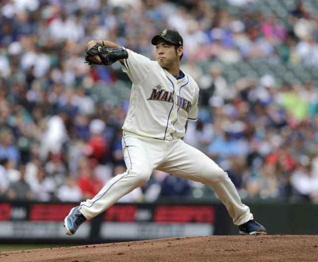 Seattle Mariners starting pitcher Yusei Kikuchi works against the Minnesota Twins during the first inning of a baseball game, Sunday, May 19, 2019, in Seattle. (AP Photo/John Froschauer)